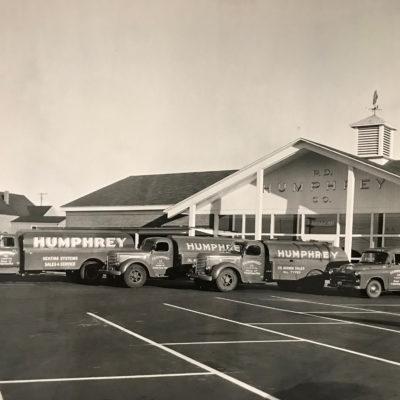 1957 (Location #2- Main Rd) Showing truck fleet
