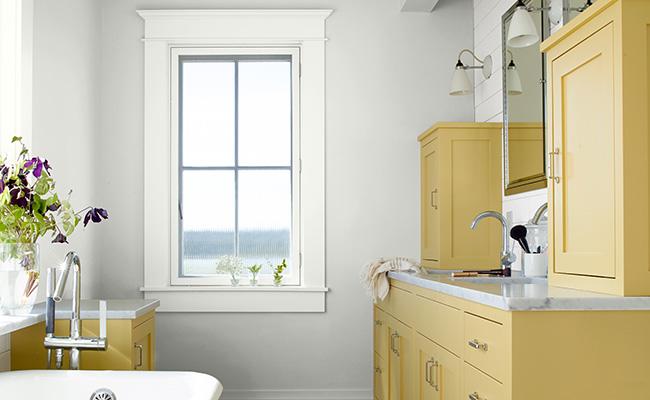 Benjamin Moore bathroom with yellow cabinets